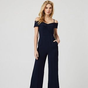 Blue jumpsuit.  Shoulder baring neckline